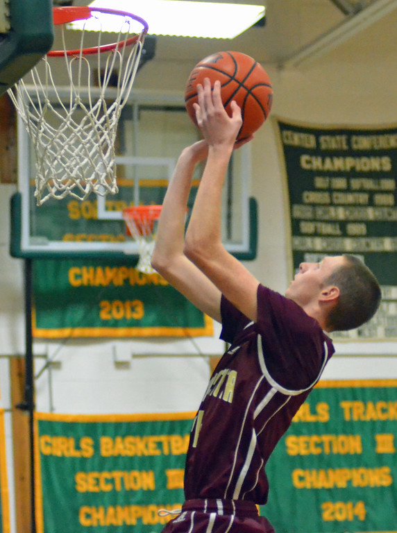 . KYLE MENNIG - ONEIDA DAILY DISPATCH Canastota\'s Jake Debrucque (34) goes up for a layup against Hamilton during their game in Hamilton on Friday, Jan. 13, 2017.