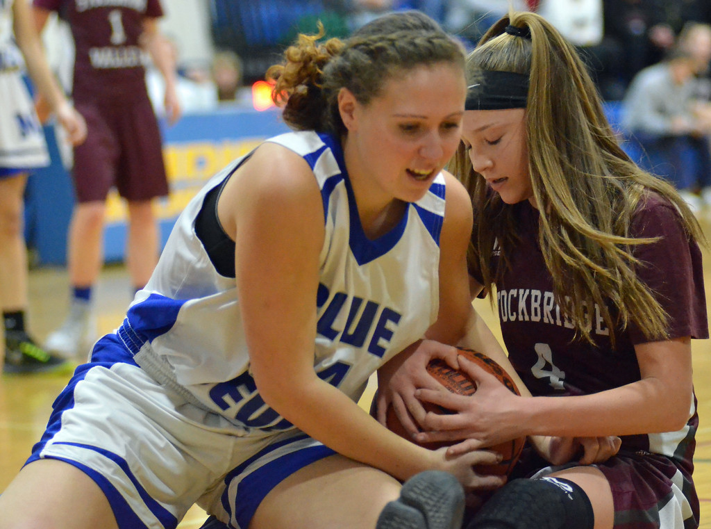 . KYLE MENNIG - ONEIDA DAILY DISPATCH Madison\'s Elisa Usborne (24) and Stockbridge Valley\'s Jillian Jacobs (4) fight for the ball during their game in Madison on Monday, Jan. 30, 2017.