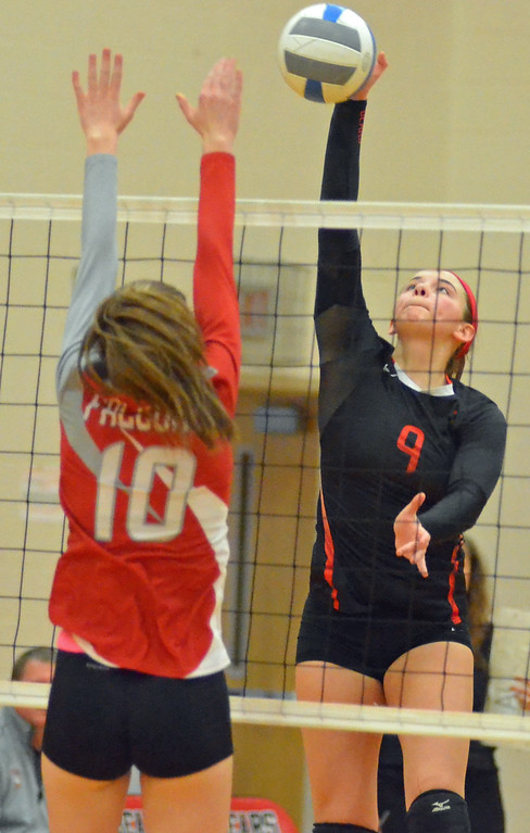 . KYLE MENNIG - ONEIDA DAILY DISPATCH Chittenango\'s Tyla Cutrie (9) hits the ball past Fabius-Pompey\'s Delaney Horst (10) during their match in Chittenango on Wednesday, Jan. 18, 2017.
