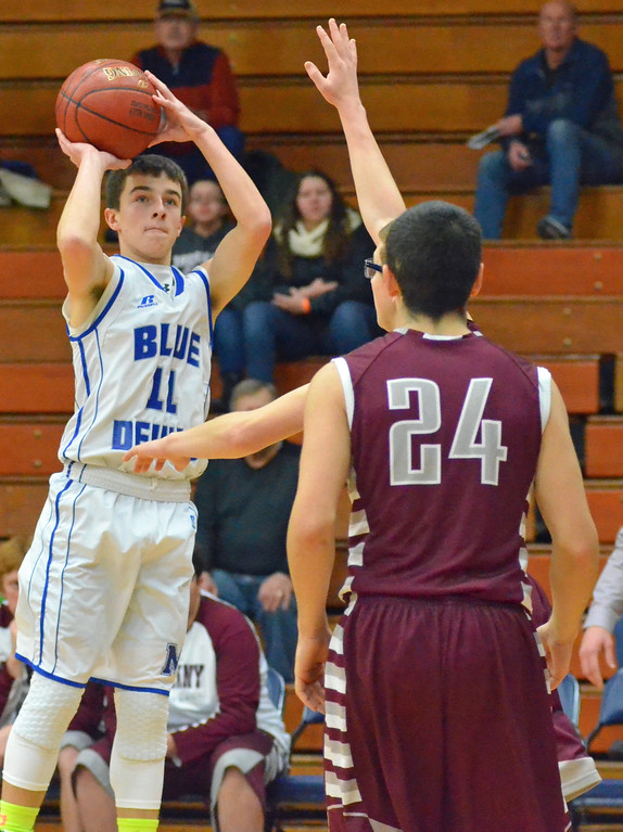 . KYLE MENNIG - ONEIDA DAILY DISPATCH Madison\'s Tyler Hummer (11) puts up an outside shot against Oriskany during their game in the Mohawk Valley Basketball Classic at Utica College on Saturday, Jan. 7, 2017.