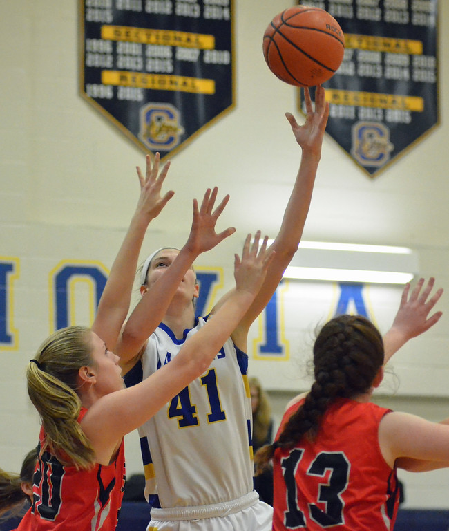 . KYLE MENNIG - ONEIDA DAILY DISPATCH Cazenovia\'s Danielle Tedesco (41) puts up a shot over Chittenango\'s Trisha Whaley (20) and Rachel Cleary (13) during their game in Cazenovia on Tuesday, Jan. 31, 2017.