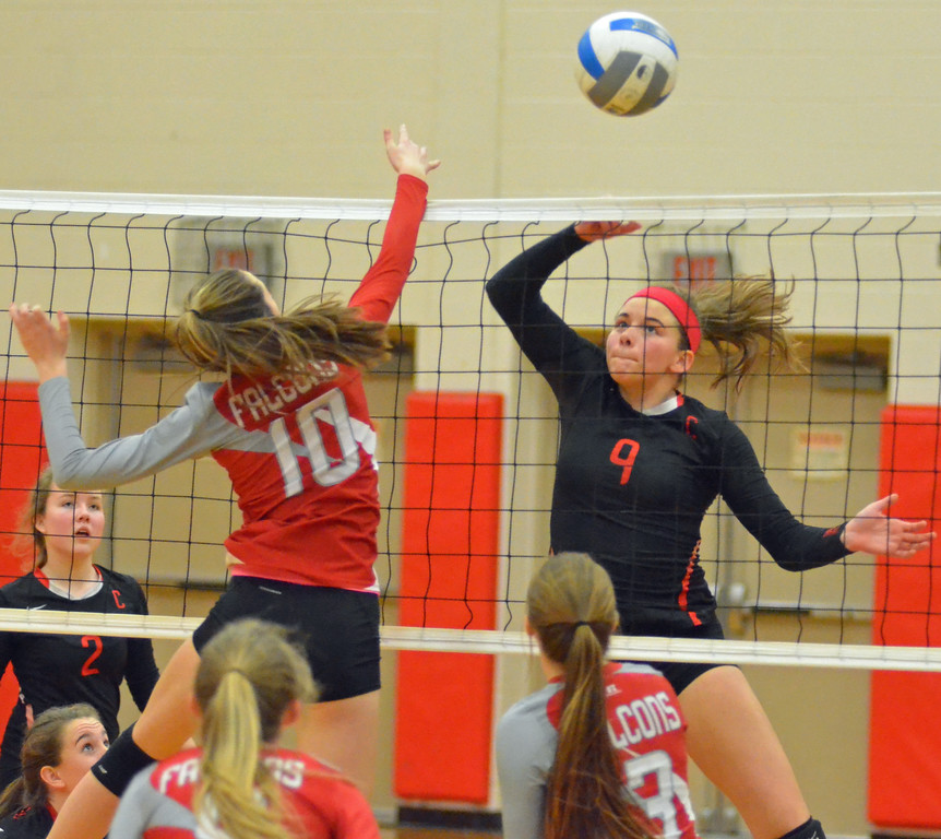 . KYLE MENNIG - ONEIDA DAILY DISPATCH Chittenango\'s Tyla Cutrie (9) tips the ball as Fabius-Pompey\'s Delaney Horst (10) hits the net during their match in Chittenango on Wednesday, Jan. 18, 2017.