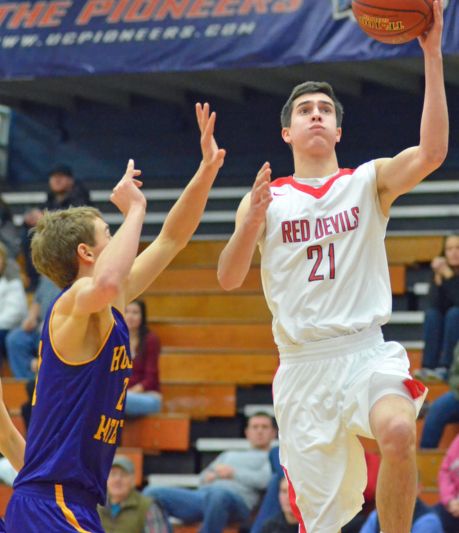 . KYLE MENNIG - ONEIDA DAILY DISPATCH Vernon-Verona-Sherrill\'s Jake Engler, right, goes up for a layup in front of Holland Patent\'s Collin Corrigan during their game in the Mohawk Valley Basketball Classic at Utica College on Saturday, Jan. 7, 2017.