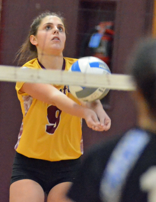 . KYLE MENNIG - ONEIDA DAILY DISPATCH Canastota\'s Loryn Wilcox (9) passes the ball against Dolgeville during their match in Canastota, N.Y., on Wednesday, Jan. 11, 2017.