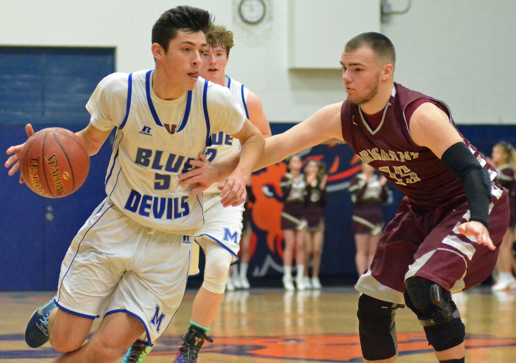 . KYLE MENNIG - ONEIDA DAILY DISPATCH Madison\'s Spencer Haviland (5) drives to the basket as Oriskany\'s Ryan Enos (15) defends during their game in the Mohawk Valley Basketball Classic at Utica College on Saturday, Jan. 7, 2017.