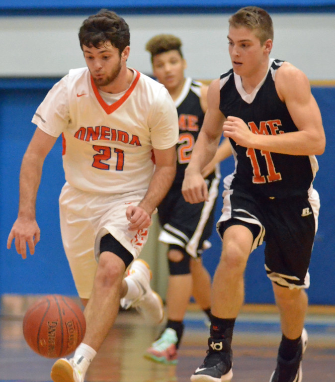 . KYLE MENNIG - ONEIDA DAILY DISPATCH Oneida\'s Vinny Leibl (21) brings the ball up the court as Rome Free Academy\'s Tristan Hunzinger (11) defends during their game in Oneida, N.Y. on Tuesday, Jan. 17, 2017. Coulter scored his 1,000th career point in the loss.