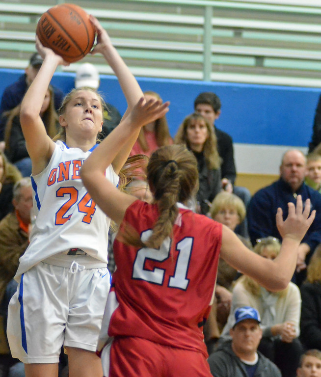 . KYLE MENNIG - ONEIDA DAILY DISPATCH Oneida\'s Julianna Cavanagh (24) puts up a shot from the outside as Vernon-Verona-Sherrill\'s Alexa Kiser (21) comes out to defend during their game in Oneida on Friday, Jan. 27, 2017.