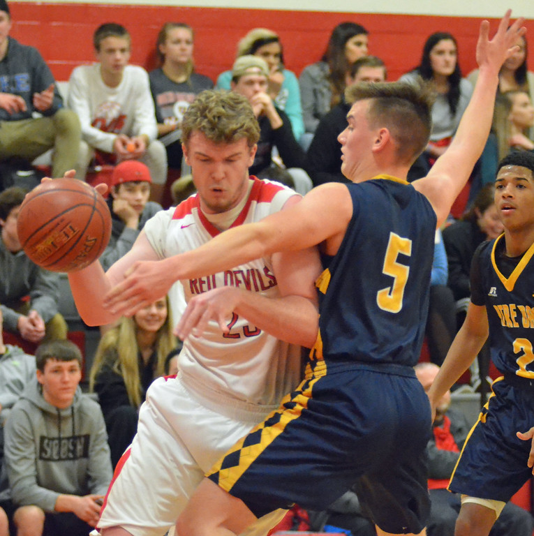 . KYLE MENNIG - ONEIDA DAILY DISPATCH Vernon-Verona-Sherrill\'s Davey Moffett (23) tries to drive baseline as Utica Notre Dame\'s Derek Lindsay (5) defends during their game in Verona, N.Y. on Friday, Jan. 20, 2017.