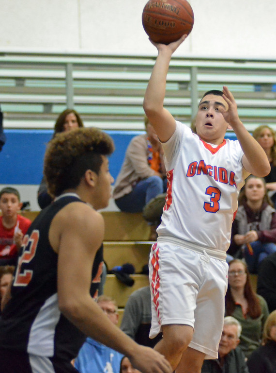 . KYLE MENNIG - ONEIDA DAILY DISPATCH Oneida\'s Alex Hawthorne (3) puts up a running shot in front of Rome Free Academy\'s Gavin Mosher (32)  during their game in Oneida, N.Y. on Tuesday, Jan. 17, 2017. Hawthorne made a school-record 11 3-pointers for Oneida in the game.