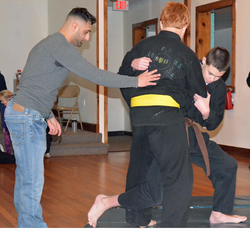 . KYLE MENNIG - ONEIDA DAILY DISPATCH Josh Ricci, left, walks Robert Merrill, right, and Randy Williamson through an inside top takedown at Waterman\'s Martial Arts Ryouzan Dojo in Oneida, N.Y. on Thursday, Jan. 19, 2017.