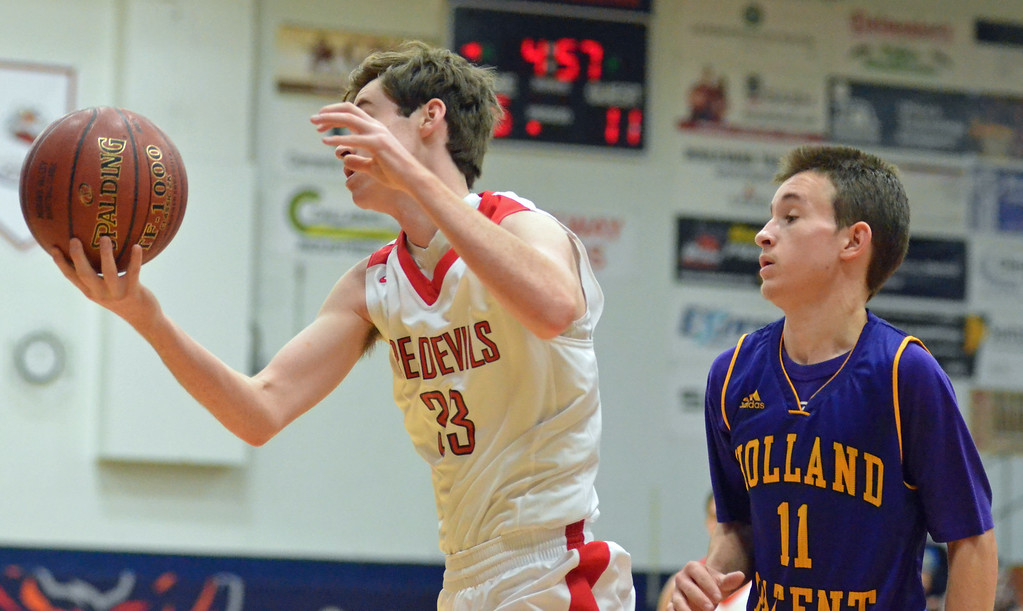 . KYLE MENNIG - ONEIDA DAILY DISPATCH Vernon-Verona-Sherrill\'s Connor VanDreason (33) comes up with a loose ball in front of Holland Patent\'s Collin Litz (11) during their game in the Mohawk Valley Basketball Classic at Utica College on Saturday, Jan. 7, 2017.