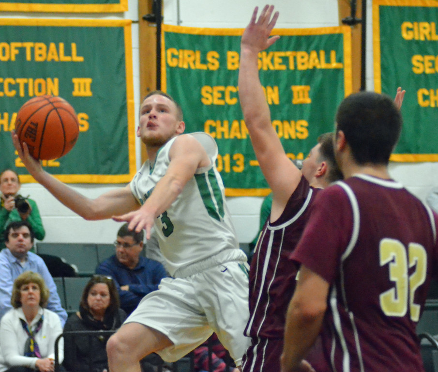 . KYLE MENNIG - ONEIDA DAILY DISPATCH Hamilton\'s Ryan Hunt (3) drives to the basket as Canastota\'s Jeff Marsh (20) defends during their game in Hamilton on Friday, Jan. 13, 2017. Also pictured is Canastota\'s James Warner (32).