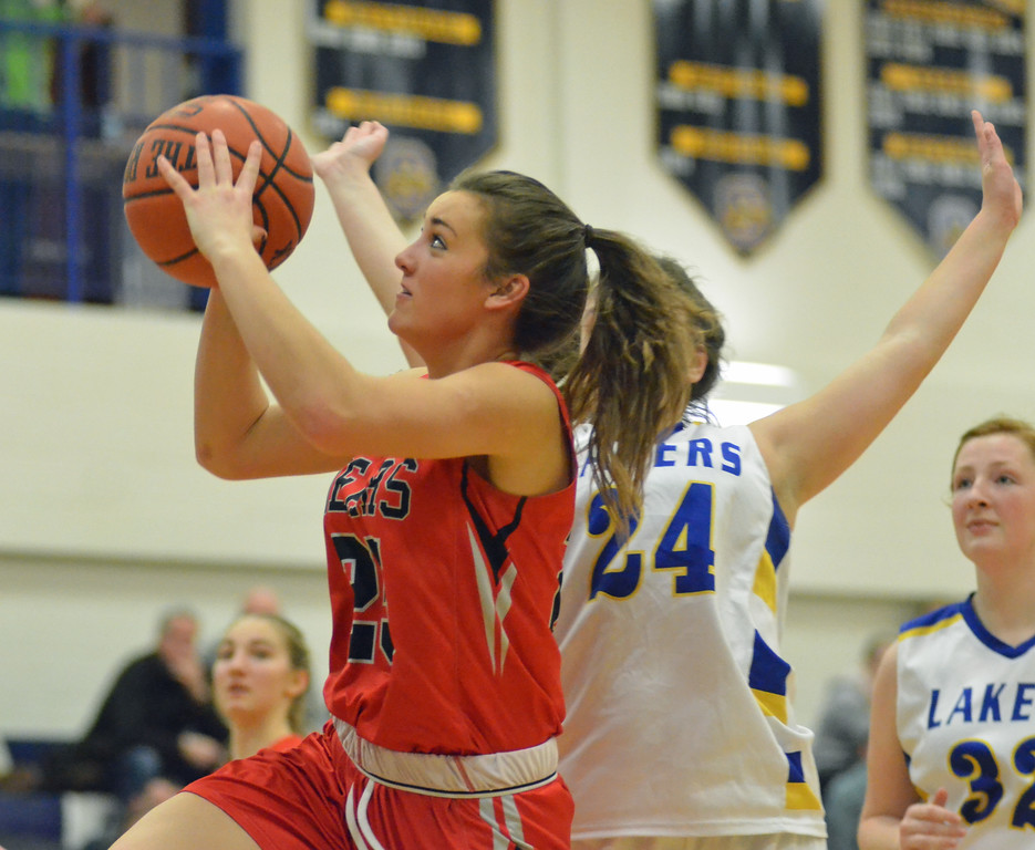. KYLE MENNIG - ONEIDA DAILY DISPATCH Chittenango\'s Sydney Bennett (25) takes a shot while driving to the basket as Cazenovia\'s Chloe Willard (24) defends during their game in Cazenovia on Tuesday, Jan. 31, 2017.