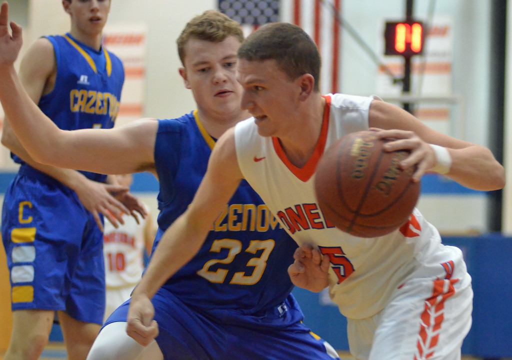 . KYLE MENNIG - ONEIDA DAILY DISPATCH Oneida\'s Jeffrey Coulter (5) drives to the basket as Cazenovia\'s Dan Kent (23) defends during their game in Oneida on Wednesday, Jan. 25, 2017.