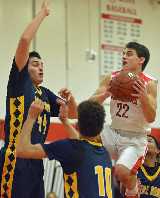 . KYLE MENNIG - ONEIDA DAILY DISPATCH Vernon-Verona-Sherrill\'s Nathan Palmer (22) drives to the basket as Utica Notre Dame\'s Nick Courto (44) and Dante Griffin (10) defend during their game in Verona, N.Y. on Friday, Jan. 20, 2017.