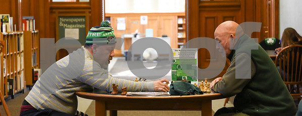 010516  Wesley Bunnell | Staff  Michael Ardrey, right, plays chess and helps teach the game to Daniel Camacho at the New Britain Public Library on Thursday afternoon.