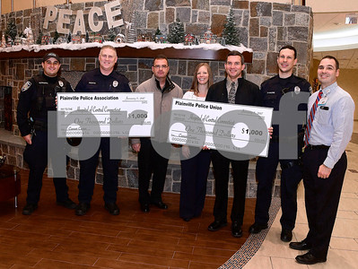 1/5/2017 Mike Orazzi | Staff Members of the Plainville Police Union and Plainville Police Association donated $2,000 to support breast cancer patients at the Hartford HealthCare Cancer Institute at The Hospital of Central Connecticut on Thursday. Left to right: Mark Kominske, Eric Giudice, Shane Dufresne, Stacey Barber, RN, OCN, operations manager, Hartford HealthCare Cancer Institute at The Hospital of Central Connecticut. David Posadas, Matt D'Amore and Regional Oncology Director for Hartford HealthCare Cancer Institute Kristoffer Popovitch.