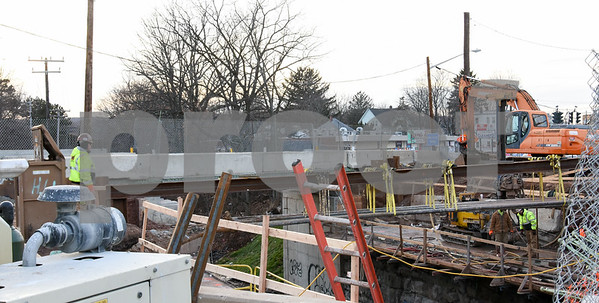 010516  Wesley Bunnell | Staff  Construction of the bridge continues on West Main St near the intersection of Burritt St.
