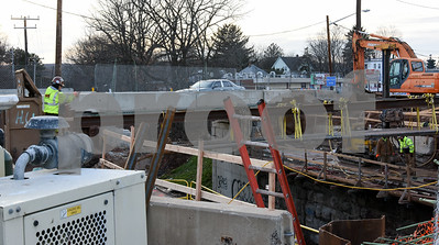 010516  Wesley Bunnell   Staff  Construction of the bridge continues on West Main St near the intersection of Burritt St.
