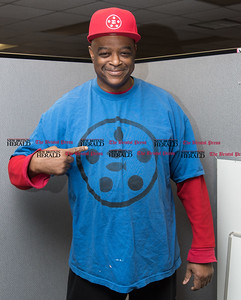 010917  Wesley Bunnell | Staff  New Britain resident Gerald Filyaw started a company named The Miracle of Loaves N Fish, which features a bible-based logo in order to inspire hope. Gerald wears a t shirt and hat with the Loaves N Fish design.