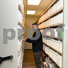 011317  Wesley Bunnell | Staff<br /> <br /> New Britain Police Detective Dave McDermott looks through case files from 2008 in the record room on Friday afternoon.