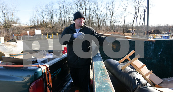 011317  Wesley Bunnell | Staff  Adam Chuchro took advantage of the mild weather to recycle household items including wooden furniture no longer needed at the New Britain recycling center.