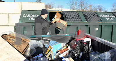011317  Wesley Bunnell | Staff  Adam Chuchro took advantage of the mild weather to recycle cardboard boxes no longer needed at the New Britain recycling center.