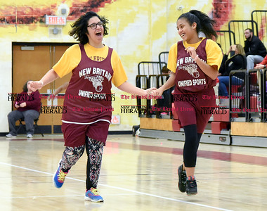 011317  Wesley Bunnell | Staff  Members of the New Britain Unified Sports Team played during halftime of the New Britain boys basketball game on Friday Jan 13th. Unified Sports, a program of Special Olympics, features an equal number of athletes with and without intellectual disabilities. Mona Moshi , left, runs down court with Natalie Deleon.