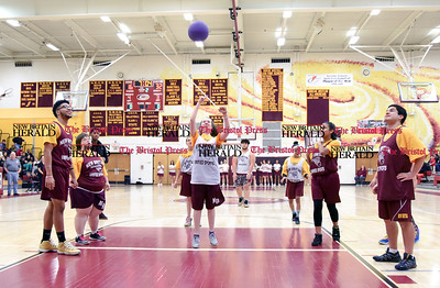011317  Wesley Bunnell | Staff  Members of the New Britain Unified Sports Team played during halftime of the New Britain boys basketball game on Friday Jan 13th. Unified Sports, a program of Special Olympics, features an equal number of athletes with and without intellectual disabilities.  Destiny Little with a shot attempt as Donovan Dorce, far left, watches along with Andrew Vega, far right.