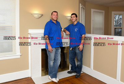 011717  Wesley Bunnell | Staff  Jack of All Trades Remodeling partners and co-owners Dan, left, and Danny St. Laurent stand in a current renovation project.