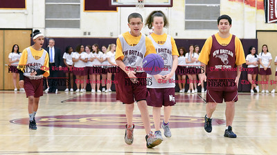 011317  Wesley Bunnell | Staff  Members of the New Britain Unified Sports Team played during halftime of the New Britain boys basketball game on Friday Jan 13th. Unified Sports, a program of Special Olympics, features an equal number of athletes with and without intellectual disabilities. Tristen Carrion dribbles down court with Christine Amaro, back far left, Destiny Little and Andrew Vega watching.