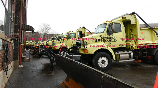 011717  Wesley Bunnell | Staff  Plows from New Britain's Department of Public Works in a row ready for upcoming storms.
