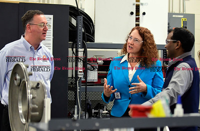 1/17/2017 Mike Orazzi | Staff Congresswoman Elizabeth Esty talks with Connecticut Tool & Manufacturing Vice President and General Manager Michael Greenwald and Yoganandan Tharanibalan on the floor of the Plainville manufacturer Tuesday.