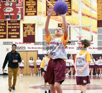 011317  Wesley Bunnell | Staff  Members of the New Britain Unified Sports Team played during halftime of the New Britain boys basketball game on Friday Jan 13th. Unified Sports, a program of Special Olympics, features an equal number of athletes with and without intellectual disabilities.  Tristen Carrion with the shot.