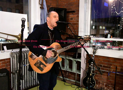 1/20/2017 Mike Orazzi | Staff Brendan Donahue performs at the Bristol Does unity in the community held at the  T Salon Hair & Nails on Main Street in Bristol Friday evening.