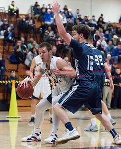 012017  Wesley Bunnell | Staff  Newington boys basketball vs Wethersfield on Friday evening at Newington High School. Matt McKinnon (21) goes baseline for a layup attempt.