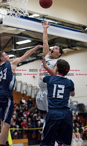 012017  Wesley Bunnell | Staff  Newington boys basketball vs Wethersfield on Friday evening at Newington High School. Timmy Rivera (23) with a floater.