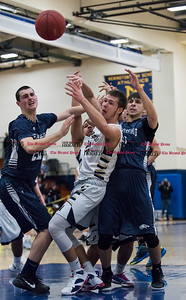 012017  Wesley Bunnell | Staff  Newington boys basketball vs Wethersfield on Friday evening at Newington High School. Matt McKinnon (21) fights for a ball with several Wethersfield defenders.