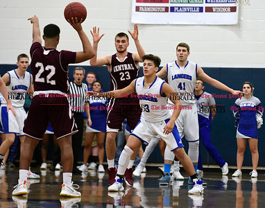 1/20/2017 Mike Orazzi | Staff Bristol Eastern's Tyler Mason (3) and Bristol Central's Isaiah Miller (22) during Friday night's game with Bristol Central at BE.