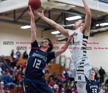 012017  Wesley Bunnell | Staff  Newington boys basketball vs Wethersfield on Friday evening at Newington High School. Matt McKinnon (21) fights for a rebound.