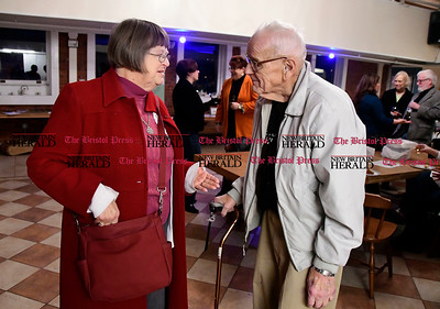 1/20/2017 Mike Orazzi | Staff Gwen Bartok talks with Bill Stortz during the Bristol Does unity in the community held at the  T Salon Hair & Nails on Main Street in Bristol Friday evening.