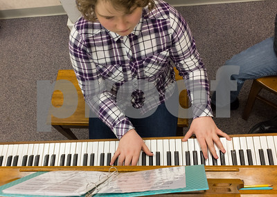 012317  Wesley Bunnell | Staff  Olivia Bartusik, age 12, takes piano lessons in New Britain's City Hall from instructor Doug Duca who is also Director of Music for St. Mary Church & St. Ann Church. The program is part of the New Britain Parks & Recreations winter programs.