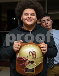 013017 Wesley Bunnell | Staff  New Britain High School held a Friends of Football 2016 Season Awards Ceremony on Monday evening in the NBHS cafeteria. John Martinez holds his Most Improved award while being photobombed by a teammate.