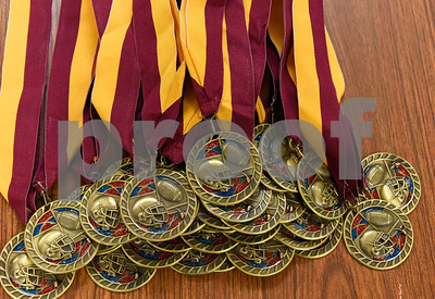 013017 Wesley Bunnell | Staff  New Britain High School held a Friends of Football 2016 Season Awards Ceremony on Monday evening in the NBHS cafeteria. Medals sit on the table ready to be awarded.