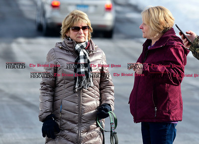 1/10/2017 Mike Orazzi | Staff Neighbors Joan Hermann and Sheran Dellabianca talk was as Connecticut State police investigate a murder on Timber Lane in Bristol Tuesday morning.