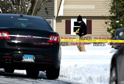 1/10/2017 Mike Orazzi | Staff State police while investigating a murder on Timber Lane in Bristol Tuesday morning.