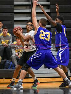 011017  Wesley Bunnell | Staff  E.C. Goodwin Tech boys basketball vs Wilcox Tech on Tuesday evening at E.C. Goodwin High School. Devin White (13)