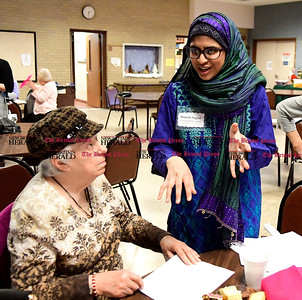"1/11/2017 Mike Orazzi | Staff Carolyn Dumais and Hunzla Sajjad during the ""Experience the World"" celebration of different cultures around the world at the Bristol Senior Center Wednesday."
