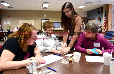 "1/11/2017 Mike Orazzi | Staff Marianna Apergis works with Deborah Foss, Dolores Ricker and Cathy Puck on an origami project during the ""Experience the World"" celebration of different cultures around the world at the Bristol Senior Center Wednesday."