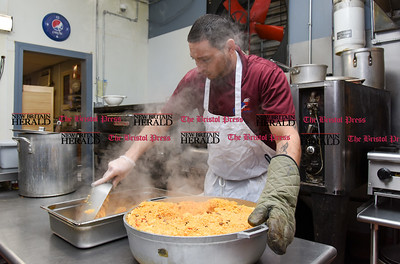 011117  Wesley Bunnell | Staff  Julio Suarez transfers a large pot of rice and beans into a serving dish at Criollisimo Restaurant on Wednesday Jan 10.